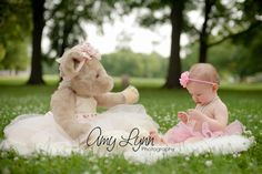 Perfect 1 year photo - baby girl and bear