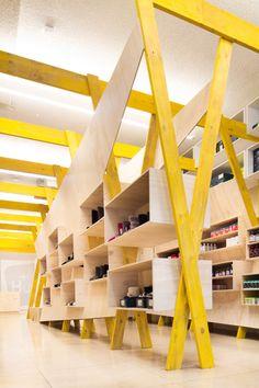 Tandem installs elaborate wooden shelving inside Hugg health and footwear store