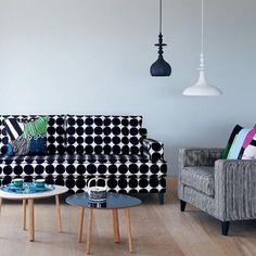Marimekko Kivet sofa - bold graphic pattern against pale wall + accent colours.