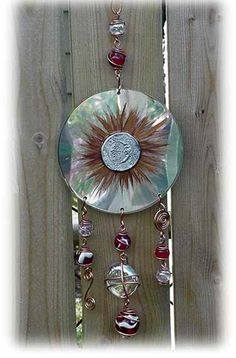first attractive repurposing of old cds. cd dangler sun catcher.