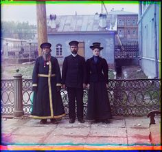 Three generations. A.P. Kalganov with son and granddaughter, who work in the shops of the Zlatoust arms plant. (1910)