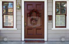 Burgundy door and 2 windows stock photo