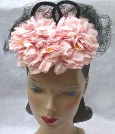 Beautiful 1940s pink flower and black net tilt hat. #vintage #1940s #hats