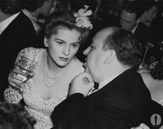 The star and director of Best Picture winner Rebecca, Joan Fontaine and Alfred Hitchcock, at the 13th Academy Awards banquet.