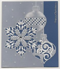 By Carolyn C.  White work Christmas card.  Design from November 2013 Parchment Craft Magazine, slightly altered.