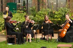 String Quartet in St James Garden. Summer outdoor Venue Hire through 195 Piccadilly, London