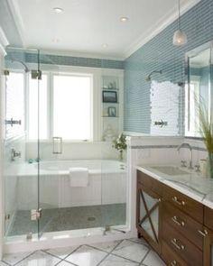 Blue glass tile walls, beautiful! Love the shower/tub take.