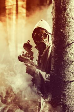 Person wearing a gas mask and holding a gun in a post-apocalyptic setting Hunter Costume, Best Zombie, Zombie Hunter, Post Apocalyptic, Apocalypse, Costumes, Costume Ideas, Guns, Darth Vader