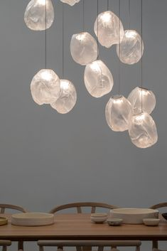 An oblong shape in gradient glass distinguishes the pendant light by Omer Arbel for Bocci—an expansion of the 73 series. The pendant's distinctive imperfect form is created by blowing molten glass into folded, heat-resistant ceramic fabric. Light Architecture, Pendant Lighting, Bocci Lighting, Pendant Chandelier, Glass Pendants, Lighting Design, Clear Glass, Decoration, Interior Design