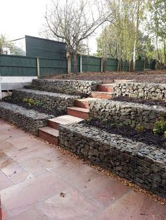 Gabion baskets of sizes - Low Cost gabion stepped retaining walls Cheaper than block stone gabion walls are easy to build ww - Walled Garden, Terrace Garden, Garden Beds, Garden Walls, Back Gardens, Outdoor Gardens, Gabion Retaining Wall, Sleeper Retaining Wall, Building A Retaining Wall