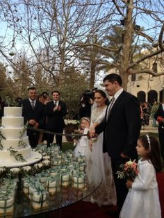 Princess Iman bint Al Hussein of Jorda and Mr.Cake Details: Olive tree branches were used to decorate the elegant white Wedding Cake, wedding favors and the centerpieces, Royal Brides, Royal Weddings, Reina Noor, Jordan Royal Family, Queen Noor, 5 Tier Wedding Cakes, Royal Cakes, Casa Real, Queen Letizia