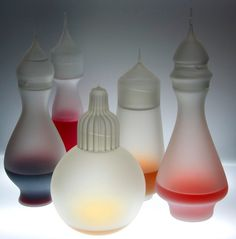 These decanters by London designers Kacper Hamilton and Ezgi Turksoy have stoppers made from found glass scraps. (UK)