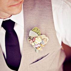 mixed media boutonniere and great coloured tie.