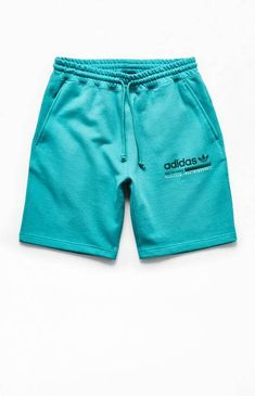 adidas supplies a fresh bold hue for your next laidback 'fit. The Kaval GRP Sweat Shorts have side-entry pockets, adidas branding on the left thigh, and a bold color design. Men's Triathlon, Sperrys Men, Under Armour Men, Gym Wear, Baby Clothes Shops, Running Shorts, Adidas Men, Soccer, Athletic Wear