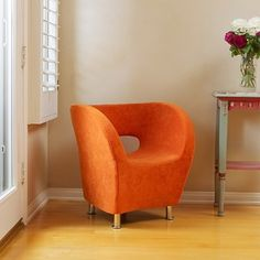 @Overstock - Add bright orange flare to any room with this modern chair. With the soft microfiber upholstery, you are sure to enjoy the comfort and style of this chair simultaneously.  http://www.overstock.com/Home-Garden/Modern-Orange-Microfiber-Accent-Chair/6055426/product.html?CID=214117 $175.49