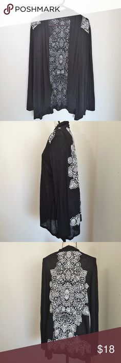 """XL JKLA black waterfall cardigan with white detail JKLA black and white waterfall cardigan. Rayon spandex material. Machine washable.   Size XL - 19"""" pit to pit, 30"""" long - see photos for details.  See photos for details. Smoke free, pet friendly home.   Please message me with any questions. Ask if additional size detail is needed.   15% discount for 3+ item bundles. Check out my closet. Happy Poshing!  669/CE JKLA Sweaters Cardigans"""