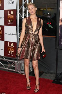 "Last night actress Elizabeth Banks walked the red carpet in J. Mendel at the Los Angeles premiere of ""People Like Us."""