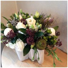 Christmas bouquet Lisianthus, Skimmia, Cones, Snowballs and Stars.