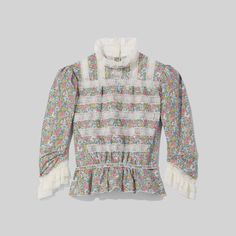 Our signature Victorian blouse features details like a stand collar and tie waist, snaps down the back and a pleated ruffle trim. Shop The Marc Jacobs Victorian Blouse. Fashion 2020, World Of Fashion, Victorian Blouse, Liberty Fabric, Lace Insert, Marc Jacobs, Ready To Wear, Men Sweater, Clothes For Women