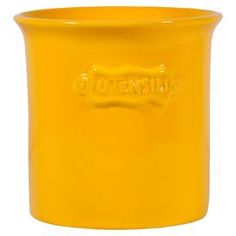 Ceramic utensil holder in yellow.  Product: Utensil holderConstruction Material: CeramicColor: YellowDimensions: 6.89 H x 7.25 W DiameterCleaning and Care: Dishwasher safe