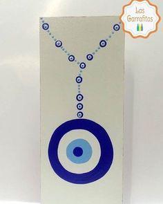 ::: O olho grego simboliza a sorte a energia positiva a limpeza a saúde a luz a paz a proteção bem como o olhar divino que protege as pessoas contra os males e a inveja. ::: Nossa página: Las Garrafitas  Insta: Las Garrafitas #lasgarrafitas #garrafas #artesanato #garrafasdecoradas #reciclar #sustentabilidade #ajudandooplaneta #viveremsantos #sustentavel #customizacao #feitoamao #decoração #lembrancinhas #Santos #cidadedesantos #pintadoamão #baixadasantista #olhogrego #quadrinho #plaquinhas…
