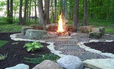 DIY fire pit designs ideas - Do you want to know how to build a DIY outdoor fire pit plans to warm your autumn and make s'mores? Find inspiring design ideas in this article. Fire Pit With Rocks, Gazebo With Fire Pit, Fire Pit Backyard, Backyard Seating, Large Fire Pit, Metal Fire Pit, Fire Pit Seating, Fire Pit Area, Seating Areas