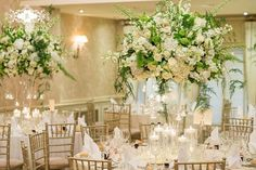 Large centerpieces must be tall like this so guests can see each other ~ Red Floral Ardchitecture
