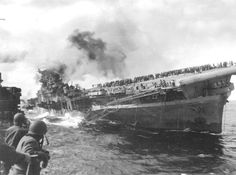March 19, 1945: USS Franklin CV-13 after being bombed by Japanese aircraft off Honshu, Japan.