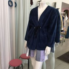 Cardigan in dark blue with sidepockets and a drawstring waist. Striped linnen skirt.