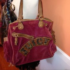 Juicy Couture Velour Raspberry Bag Raspberry velour  bag with brown leather and plaid trim. Antique gold hardware, several pockets inside and out, signature heart-shaped Juicy attached inside. ❌❌Bag is in mint condition; leather trim is worn. bottom has scratches ❌❌❌ Juicy Couture Bags