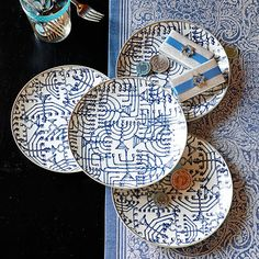 Hanukkah Plates ~  Evocative of a rich and beautiful tradition, our deep blue and creamy white porcelain plates recall ancient temple menorahs. Each plate has a simple silver-tone band to further grace your celebration meal. Use the plates throughout the season, for everything from appetizers to salads to desserts.   @ Williams-Sonoma