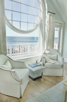 Beach house with a beautiful view through a round window... House of Turquoise: Bliss Home and Design