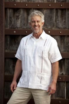 """http://theguayaberashirtstore.com Here's a new style Guayabera based on the traditional """"classic""""pattern.    The beach wedding attire that looks great.    This 100% linen Guayabera features pleated front and back ornamentation, four pockets and a special """"Aggie Maroon"""" X pattern embroidery trim."""