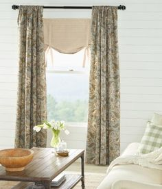 A classic, elegant paisley design is printed on textured linen blend fabric. (Country Curtains Paisley Jacobean Lined Rod Pocket Curtains. Available in Mineral, Black and Natural.)