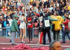 David Hemery (GBR) - Bronze medal, congratulates Akii Bua (Uganda) on winning the gold medal . Mens 400m hurdles final. Munich Olympics 1972.
