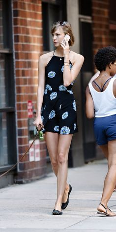 Karlie Kloss is every bit the NYC it-girl, teaming a flippy floral sundress with simple ballet flats on the streets of New York.