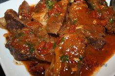 Swiss Steak  Very Tender meat that is filled with lots of flavor and makes a great sauce.