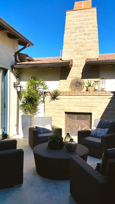 Courtyard with stone, #outdoor fireplace.