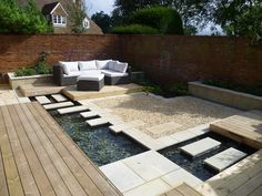 contemporary courtyards | Contemporary courtyard - young plants still to cover walls