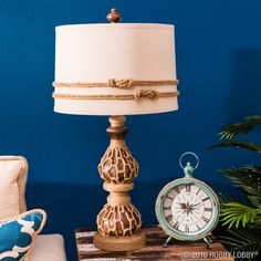 Try embellishing a plain-Jane lamp with jute rope and sailor knots for a nautical twist on your decor! For this look, we adhered our rope with hot glue. TIP: Start all seams in the back of lamp for a cleaner look.