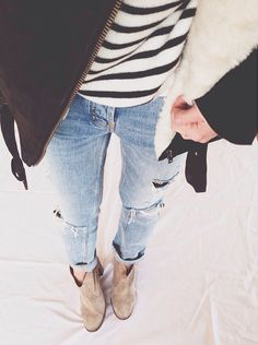i love the black and white stripes with the color of jeans. the boots add a nice touch!