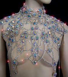 "The Decadence Necklace    A Genuine Austrian Crystal Rhinestone Necklace; for seriously glamorous people!    The necklace is 10 1/2"" long in total (top to bottom). The body width is 14 1/2"" wide.    Necksize is adjustable from 16"" to 18 1/2"". 2 body chains hold the piece in place in the back.    The necklace comes in a silvertone setting finishes with a mix of clear and AB fancy stones.     Neat!!!"