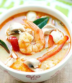 Thai Tom Yum Shrimp Soup Recipe INGREDIENTS 1 can (14.5 oz) chicken broth (1 3/4 cups) 4 cups water 3 stalks lemongrass, white part only, pounded (sounds weird but has a great taste) 2-inch piece ginger, sliced 12 kaffir lime leaves (they smell amazing and add a great taste) 3 Tbsp Thai roasted chili paste 1/2 lb shrimp, shelled and deveined 1 red chilies, deseeded, cut into thick strips (wear gloves!) 2 1/2 Tbsp fish sauce 3/4 cup coconut milk 1 big lime, juiced Mushrooms are optional
