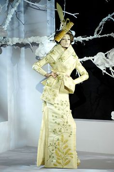 Christian Dior Spring 2007 Couture by John Galliano. Only 3 of the 45 models sent down the runway were of Asian descent. Imagery included obi tied to the front, bamboo, fans, origami, hair ornaments and geisha makeup