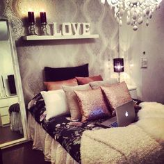 mirror next to bed, interesting idea. also like the shelf above the bed for bedframes with no headboard