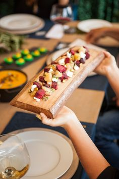 Beet salad served on a plank board
