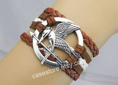 Mockingjay pin braceletbrown leather braceletAncient by charmcover, $7.99
