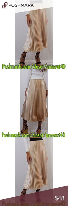 """Gold Velvet Keepsake Skirt Gold Velvet Keepsake Skirt  Velvet look details add a pretty touch to this midi skirt. Sitting high on the waist, the full skirt comes in a pleated texture. Pair with an oversized sweatshirt and trainers for edgy chic. 92% Polyester, 8% Elastane  * 95% polyester, 5% spandex * Hand wash cold * Model is in size S * Model is 5'9"""", bust 34"""", waist 25"""", hips 35"""" Alpha Omega Skirts Midi"""