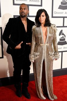 Kanye West and wife Kim Kardashian arrive at the 57th Annual GRAMMY Awards in black and gold on Feb. 8 in Los Angeles