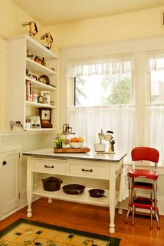 Maybe Grandma will let me have her red stool identical to the one in the photo.  Love the charm of this old kitchen and could see this in ours